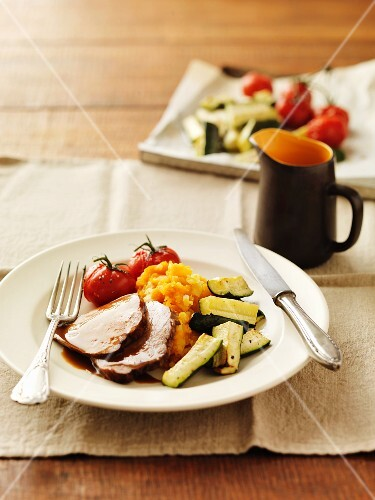 Balsamic roast beef with mashed sweet potatoes, courgettes and tomatoes