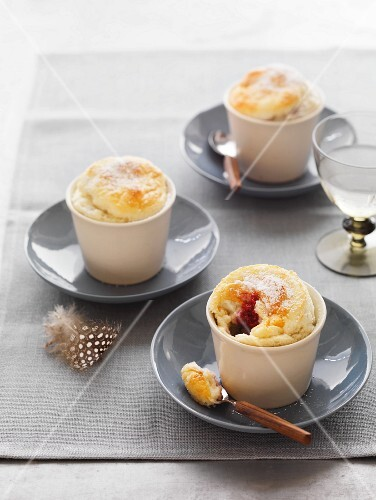 Berry soufflés with icing sugar