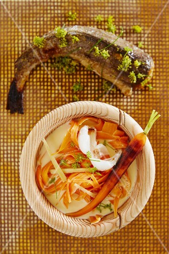 Carrot and coconut soup with fried fennel hake