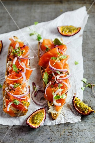 Baguette topped with smoked salmon and passion fruit