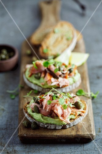 Rye bread topped with avocado cream and smoked salmon
