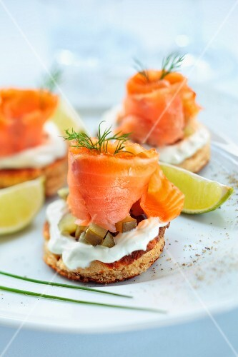 Blinis topped with smoked salmon, cream and gherkins