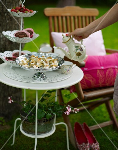 Pear and cheese canapés with walnuts, doughnuts and tea for a croquet garden party