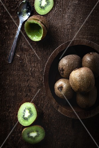 Kiwis on wooden surface
