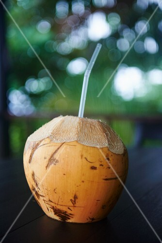 A coconut with a straw