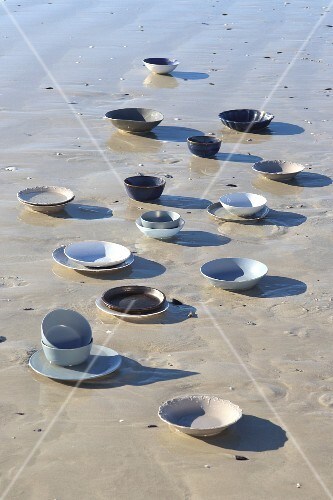 Plates and bowls on beach