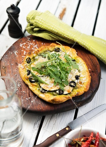 Vegetable pizza with cheese and rocket