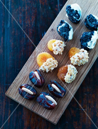 Dried fruit sweets on a wooden platter