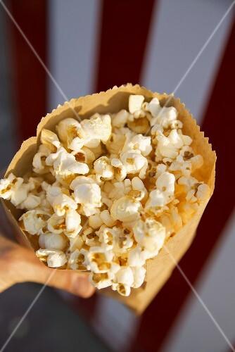 A paper bag full of popcorn
