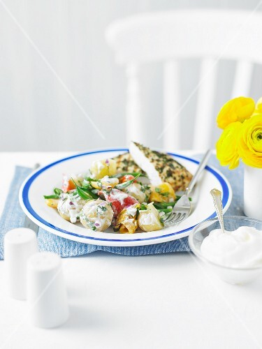 Potato salad with vegetables and chicken escalope with a herb crust