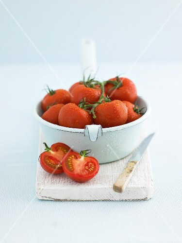 Freshly washed tomatoes, one halved