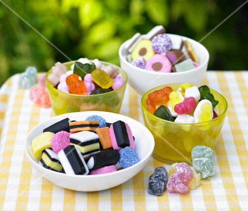 Four bowls of colourful sweets