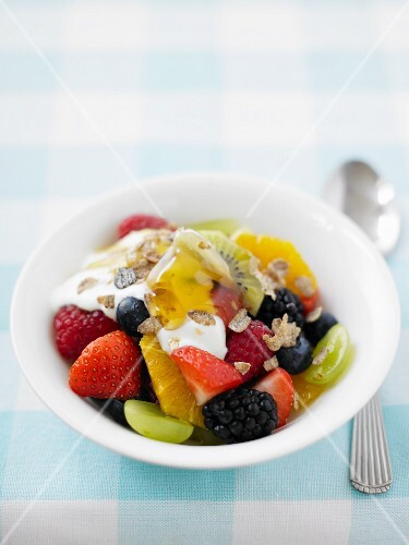 Fruit salad with yoghurt and maple syrup
