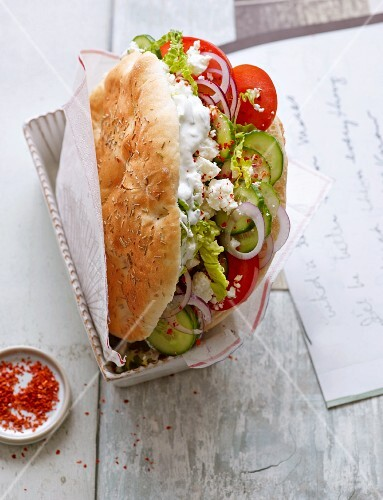 Veggie donner with tomatoes, cucumber and sheep's cheese
