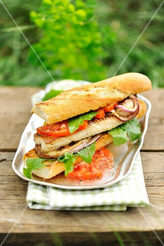 A catfish sandwich with grilled vegetables