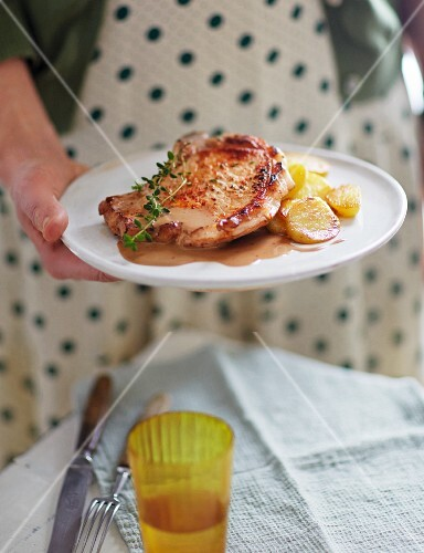 A pork chop with a honey and balsamic source