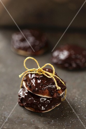 Chocolate and ginger biscuits tied with a ribbon