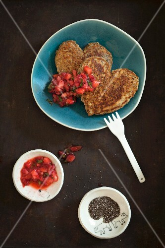 Heart-shaped pancakes with chia seeds and tomato salsa