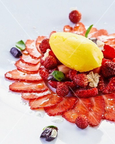Strawberry carpaccio with wild strawberries and mandarin sorbet