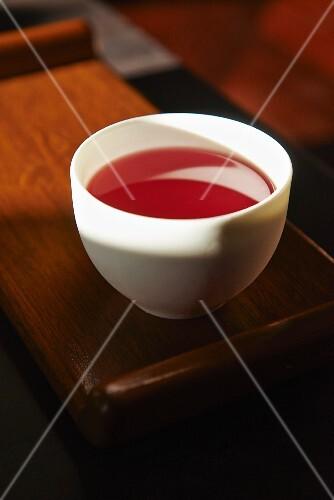 Orange tea with red basil