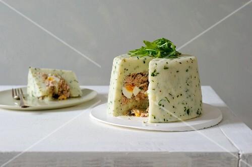 Potato Charlotte with tuna and egg