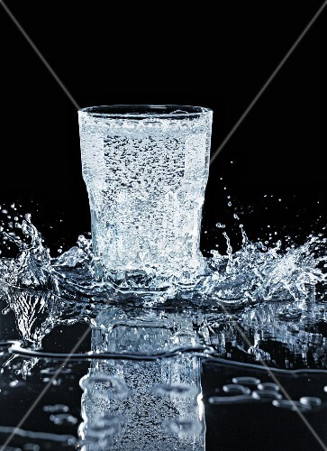 A water glass with a splash