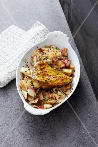 Curried turkey escalope on a bed of apple sauerkraut