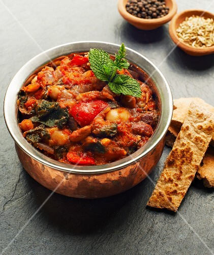 A casserole made with beans, peppers and spinach