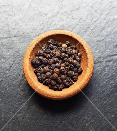 A bowl of black peppercorns