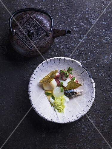 A scallop, squid and caviar with wasabi crème fraîche