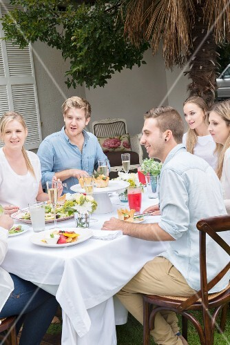 Young people eating together