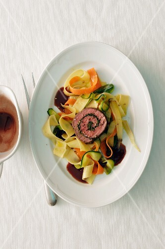 Beef roulade on a bed of vegetable tagliatelle