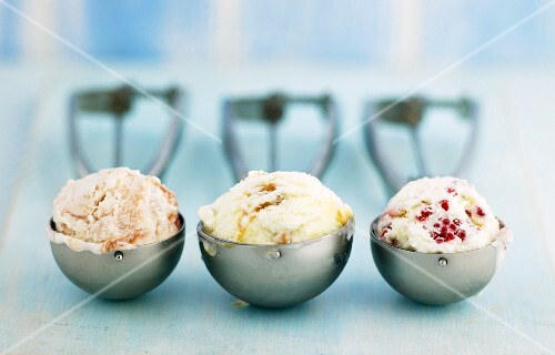 Various different types of ice cream in scoops