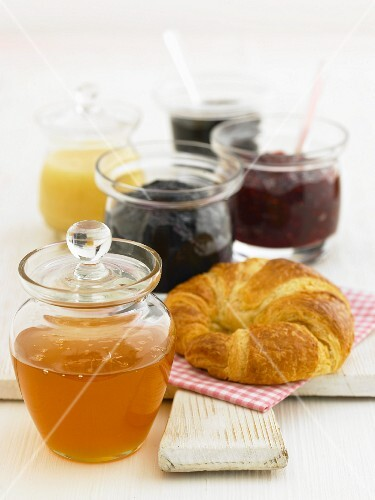 Various types of jams and jellies in jars