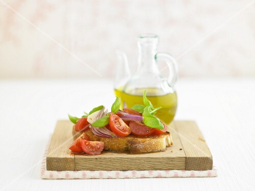 Rustic bruschetta with tomatoes, red onions, olive oil and basil