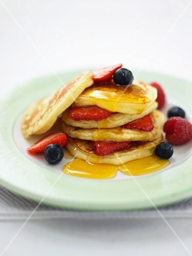 Pancakes with summer berries and maple syrup
