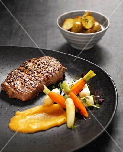 Beef steak with carrots, asparagus and potatoes