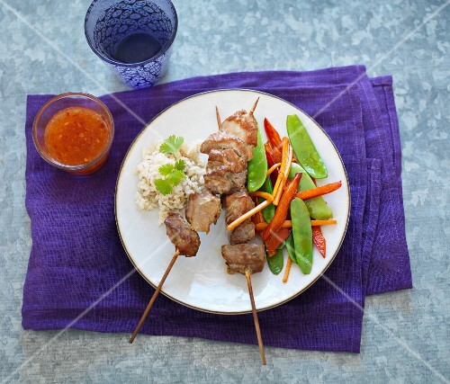 Pork skewers with rice and mange tout (Thailand)