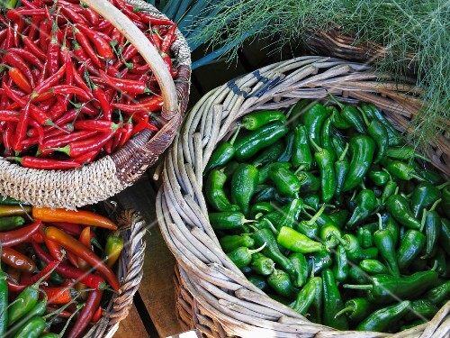 Various chilli peppers in baskets
