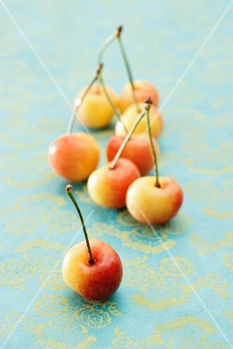 Pairs of yellow cherries