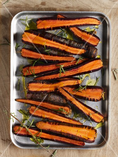 A tray of oven-ready organic purple carrots