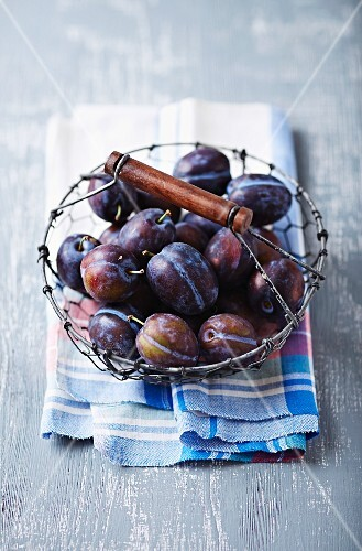 Plums in a wire basket