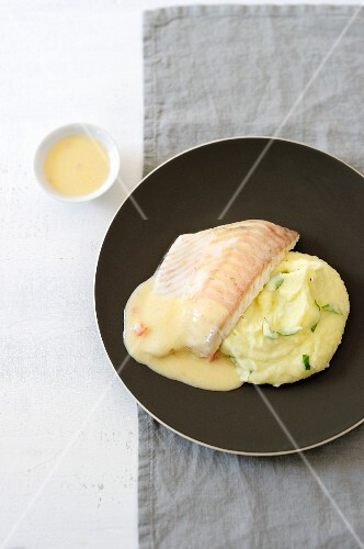 Poached turbot with fish sauce and mashed potatoes