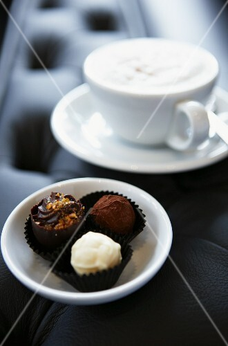 Chocolate pralines and a cappuccino