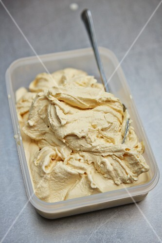 Homemade toffee ice cream in a plastic container