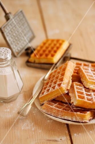 Homemade waffles with icing sugar