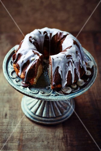 Marble cake with chocolate glaze on a cake stand