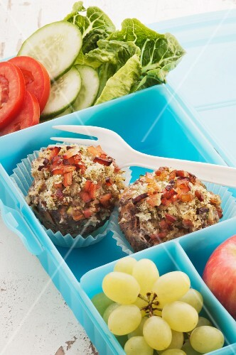 Meatballs, grapes and a salad in a lunchbox