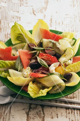 Summer salad with vegetables and watermelon