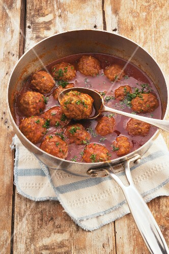 Sweet and sour meatballs in a pan